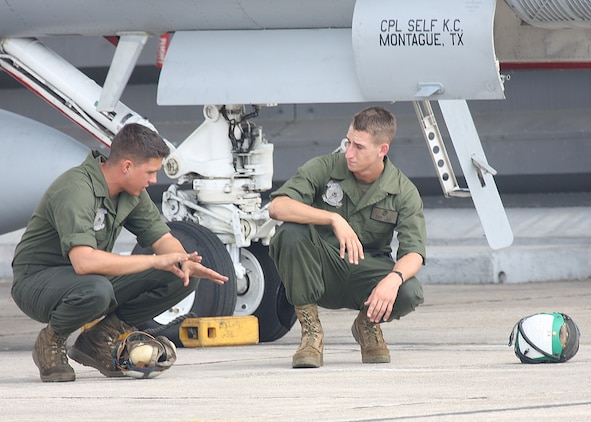 Marines with Marine Fighter Attack Squadron 112 preform maintenance on an aircraft, Royal Malaysian Air Force Base Butterworth, Malaysia. The Cowboys returned to Iwakuni and are prepareing for their next deployment.