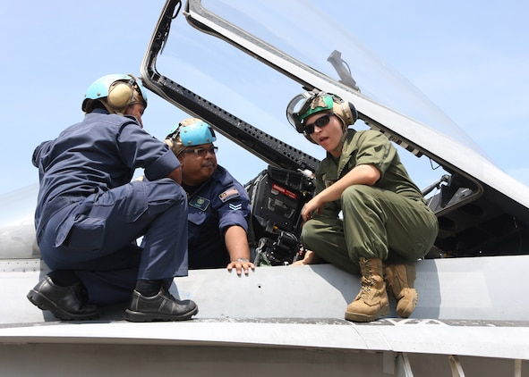 Marines with Marine Fighter Attack Squadron 112 preform maintenance to an aircraft, Royal Malaysian Air Force Base Butterworth, Malaysia. VMFA-112 is currently in Iwakuni preparing for its next deployment.