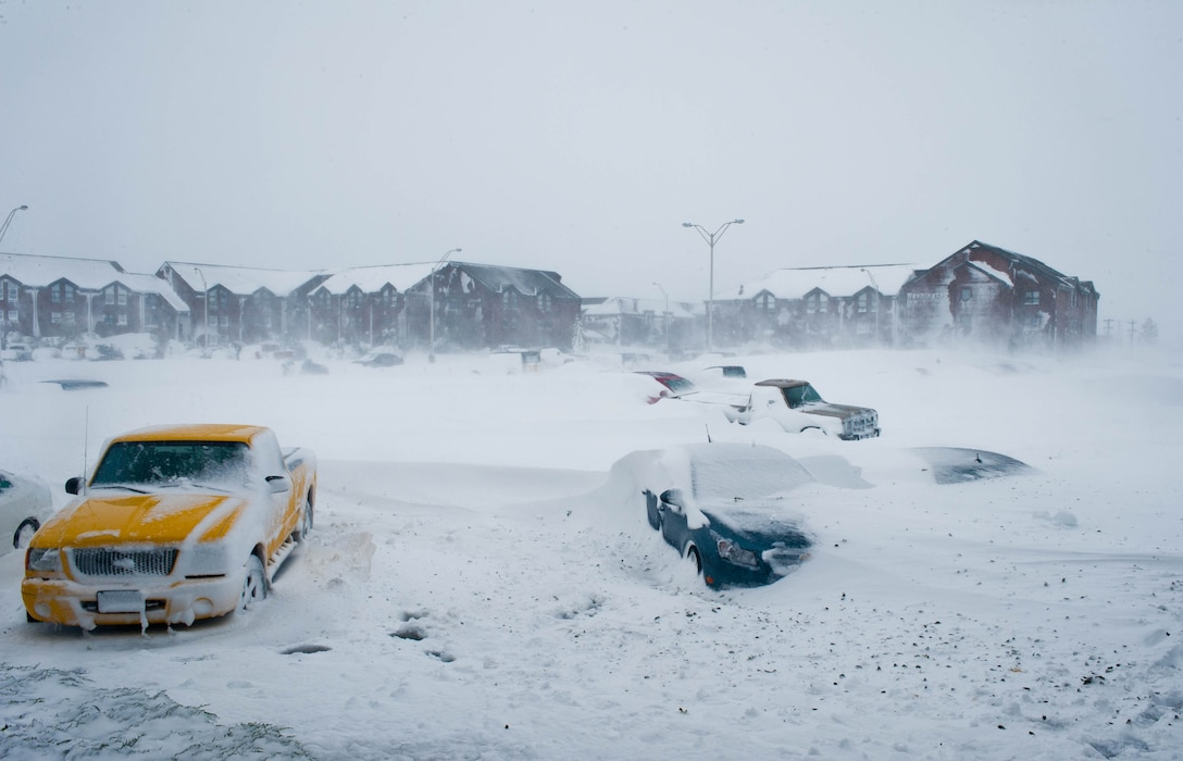 Vehicles sit buried under snow in a dormitory parking lot at Ellsworth Air Force Base, S.D., Oct. 5, 2013 during a snowstorm. The average annual amount of snowfall in South Dakota was 24 to 30 inches across most of the state, and 60 to 100 inches in the Black Hills. (U.S. Air Force photo by Senior Airman Zachary Hada/Released)