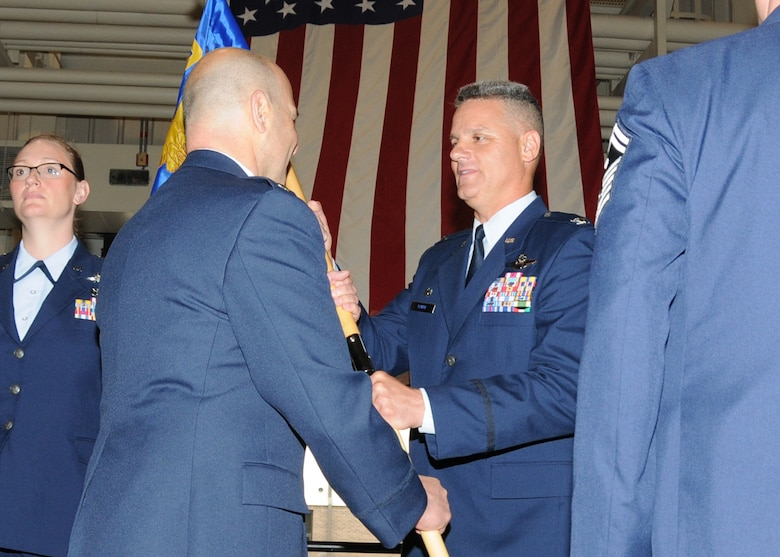 Lieutenant Colonel Anthony Hamel, incoming Commander of the 143d Mission Support Group, assumes Command from Col Arthur Floru, 143d Airlift Wing Commander, during a Change of Command ceremony for the 143d MSG. National Guard Photo by Technical Sergeant Jason Long