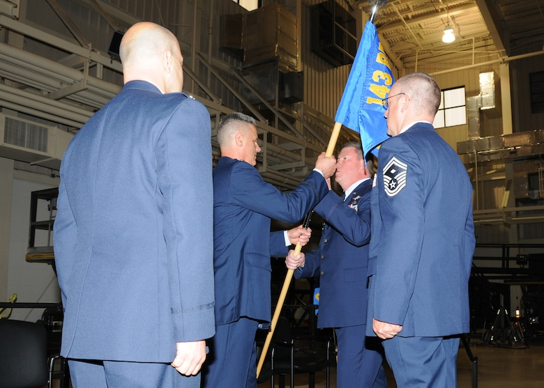 Colonel John Reed, outgoing Commander of the 143d Mission Support Group, relinquishes Command to Col Arthur Floru, 143d Airlift Wing Commander, during a Change of Command ceremony for the 143d MSG. National Guard Photo by Technical Sergeant Jason Long