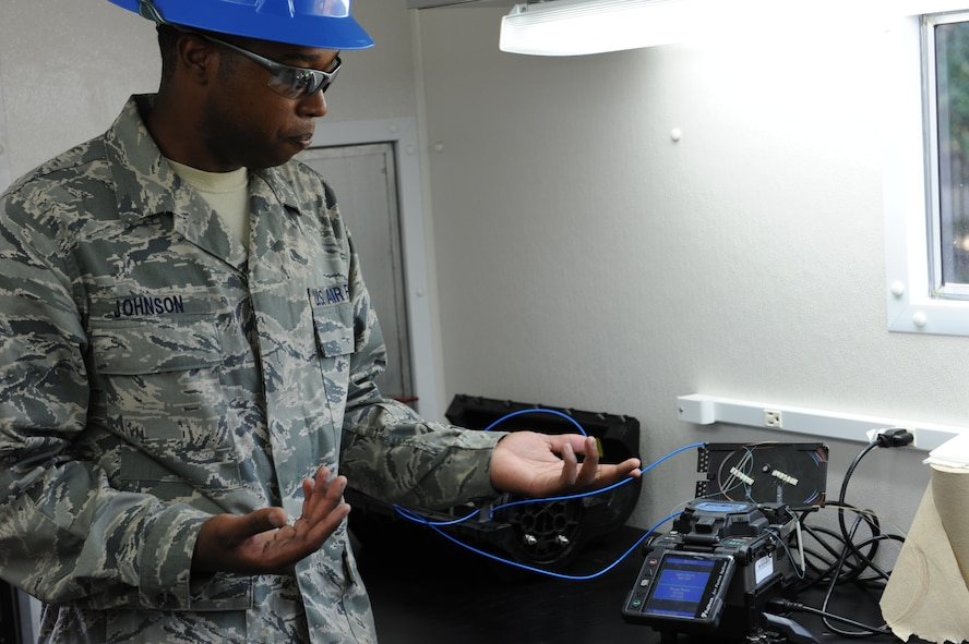 Staff Sgt. Irvin Johnson, 85th Engineering Installation Squadron, demonstrates new equipment to 81st Training Wing leadership during the 85th EIS open house Oct. 3, 2013, Keesler Air Force Base, Miss. The open house was held to educate leadership on the unique services and day-to-day operations of the Air Force's only active duty engineering installation squadron. (U.S. Air Force photo by Airman 1st Class Stephan Coleman)
