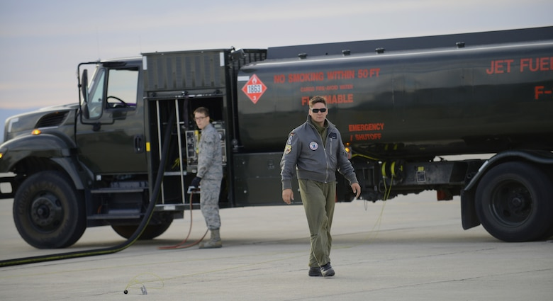 U.S. Air Force Airman 1st Class Aaron Dunn 366th Logistics Readiness Squadron fuels operator, operates his R-11 refueler Oct. 7, 2013, at Mountain Home Air Force Base, Idaho while a German Air Force maintainer walks by. The GAF currently has more than 10 AG-51 Tornados flying around the clock training missions for the Mountain Roundup exercise. (U.S. Air Force photo by Senior Airman Benjamin Sutton/RELEASED)
