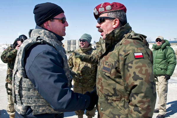 U.S. Deputy Defense Secretary Ashton B. Carter greets a Polish battle group commander on Forward Operating Base Ghazni, Afghanistan, Feb. 23, 2012. Carter is in Afghanistan meeting with troops and NATO members.