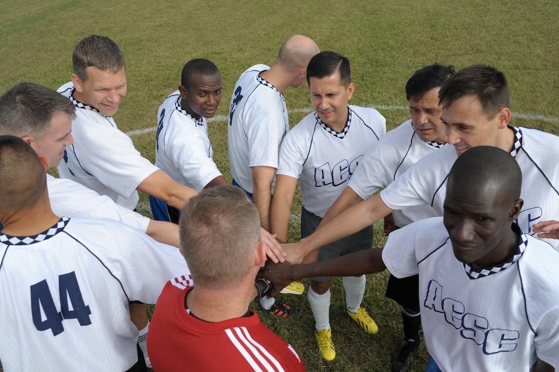 Students from Air Command Staff Collegeprepare for a soccer game against Air War College on Maxwell Air Force Base, Oct. 8. The game was part of a 2-day competition between the academic powerhouses compiling of approximately 20 events, both scholastic and athletic. (U.S. Air Force photo by Airman 1st Class William Blankenship)