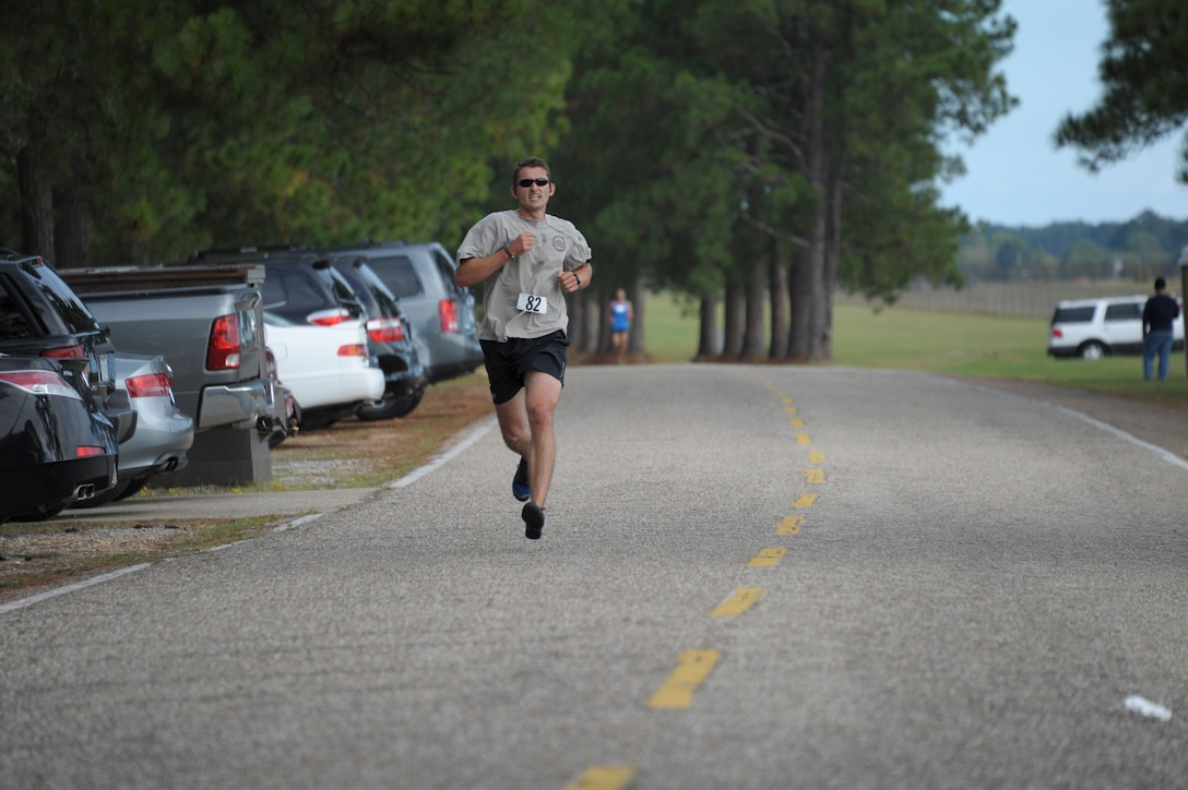 A student from Air Command and Staff College competes in a 5K race on Maxwell Air Force Base, Oct. 8. The race was part of a 2-day competition between ACSC and Air War College, compiling of approximately 20 events, both scholastic and athletic. (U.S. Air Force photo by Airman 1st Class William Blankenship)