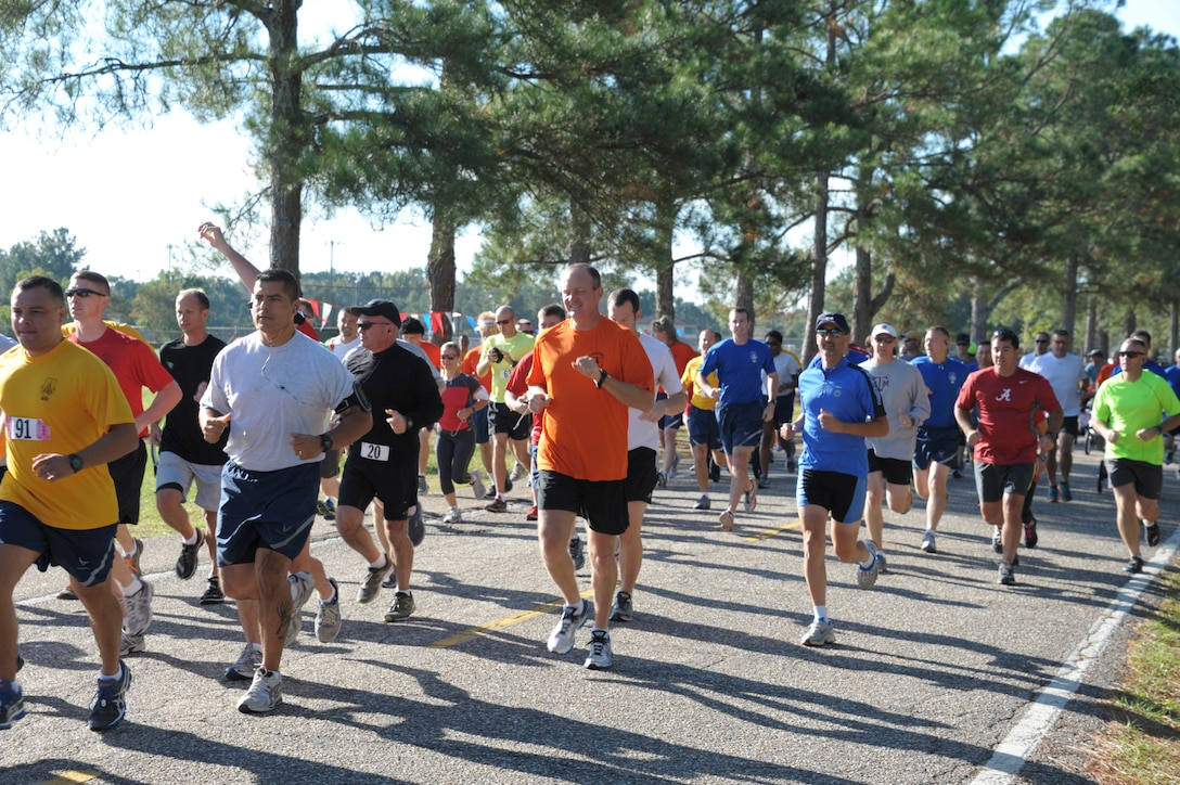 Students from Air War College and Air Command Staff College compete in a 5K race on Maxwell Air Force Base, Oct. 8. The race was part of a 2-day competition between the academic powerhouses compiling of approximately 20 events, both scholastic and athletic. (U.S. Air Force photo by Airman 1st Class William Blankenship)