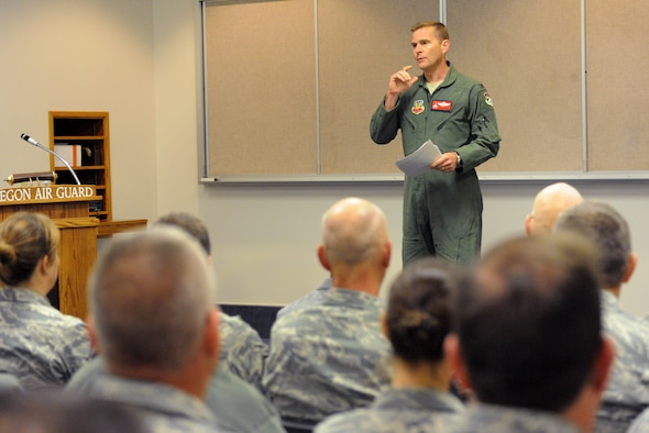 Oregon Air National Guard Col. Richard Wedan, 142nd Fighter Wing Commander, address Airmen of the 142nd Fighter Wing at the Portland Air National Guard Base, Ore., Oct. 8, 2013, during a Town Hall meeting to discuss the current conditions of the unit and members as a result of the U.S. Government shutdown.  (Air National Guard photo by Tech. Sgt. John Hughel, 142nd Fighter Wing Public Affairs/Released)