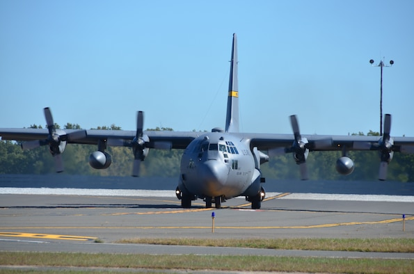 The first of eight C-130H aircraft expected to be assigned to the Connecticut Air National Guard's 103rd Airlift Wing taxies onto the flightline at the Bradley Air National Guard Base moments after it touched down at Bradley International Airport, Windsor Locks, Conn., Tuesday, Sept. 24, 2013. (U.S. Air National Guard photo by Maj. Jefferson Heiland)