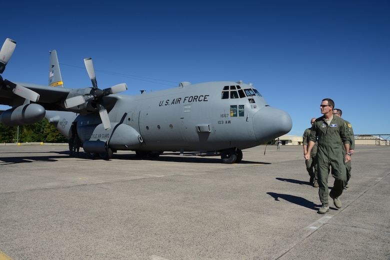 Col. Frank Detorie, commander of the 103rd Airlift Wing, looks back at the first of eight C-130H aircraft expected to be assigned to the Connecticut Air National Guard's 103rd Airlift Wing after inspecting the aircraft shortly after it touched down at Bradley International Airport, Windsor Locks, Conn., Tuesday, Sept. 24, 2013. (U.S. Air National Guard photo by Master Sgt. Erin McNamara)