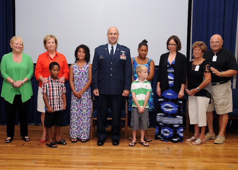 Colonel Anthony Hamel, Commander, 143d Mission Support Group, and his family pose for a photo following his pinning to Colonel. National Guard photo by Master Sgt Janeen Miller