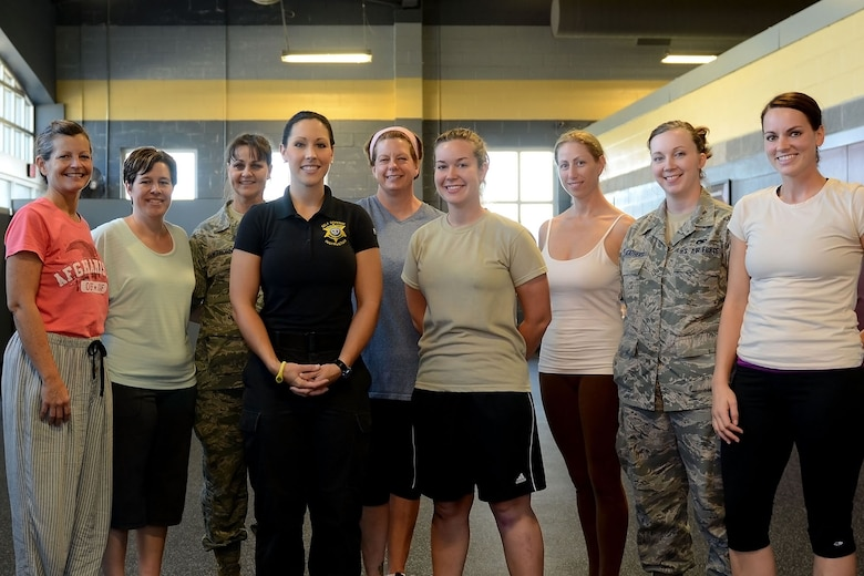 """U.S. Air Force Airmen assigned to the 169th Fighter Wing at McEntire Joint National Guard Base, South Carolina Air National Guard, participate in a """"females only"""" self-defense class provided by the Richland County Sheriff's Department, Oct. 6, 2013.  (U.S. Air National Guard photo by Tech. Sgt. Caycee Watson/Released)"""