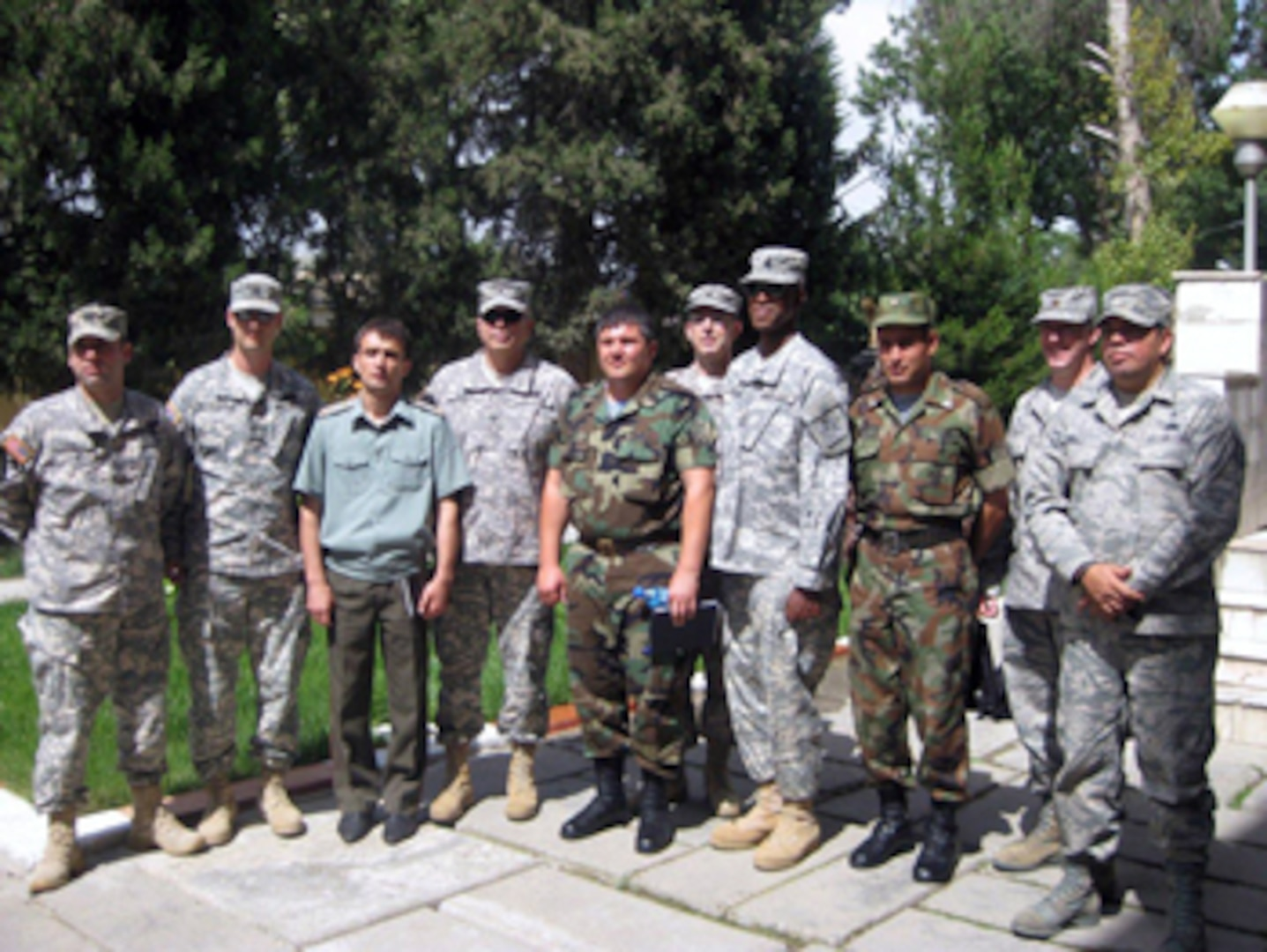 A group of Citizen-Soldiers and -Airmen from the Virginia National Guard meet with the commander of the PKO battallion and some of his staff members during a trip to Tajikistan, June 13 to 19, 2011.