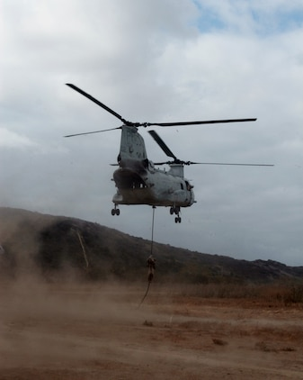 MARINE CORPS BASE CAMP PENDLETON, Calif. – A Marine serving with Kilo Company, 3rd Battalion, 5th Marine Regiment, fast ropes from a CH-46 Sea Knight helicopter during a training exercise here, Oct. 9, 2013. Fast roping allows Marines to quickly enter an area without the need for a landing zone. The technique is often employed during raids, enabling forces to rapidly secure an objective. The battalion is scheduled to deploy next spring as the battalion landing team for the 31st Marine Expeditionary Unit in Okinawa, Japan. Kilo Co. is currently assigned as the helicopter element within the battalion landing team.