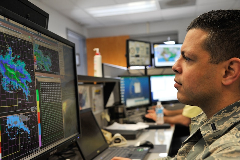 U.S Air Force 1st Lt. Jose Melendez, 509th Operation Support Squadron wing weather officer, examines weather radar readouts, Whiteman Air Force Base, Mo., March 20, 2013. In light of Hispanic Heritage Month, Melendez said Hispanics should be proud and never forget the importance of their contributions to the Air Force and nation. (U.S. Air Force photo by Airman 1st Class Keenan Berry/Released)