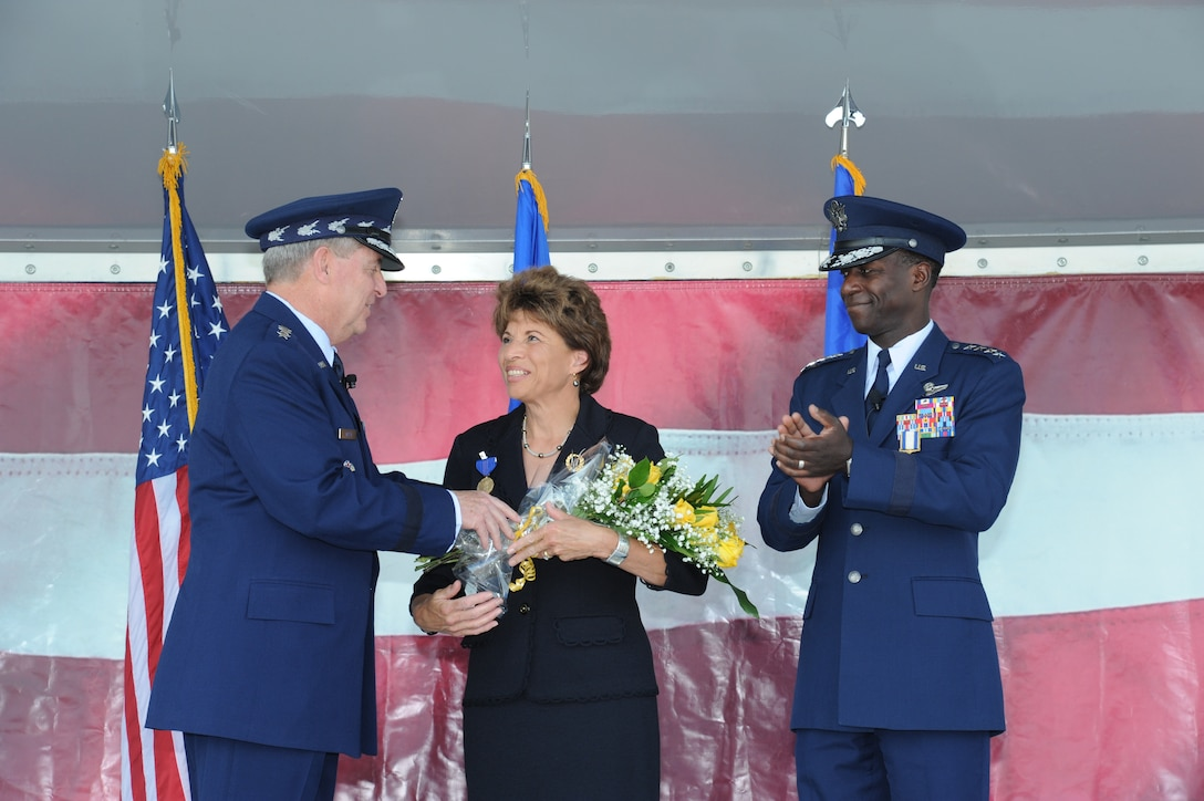 JOINT BASE SAN ANTONIO-RANDOLPH, Texas -- Teresa Rice, wife of Gen. Edward A. Rice Jr. (right), former Air Education and Training Command commander, received the Exceptional Service Award from Air Force Chief of Staff Gen. Mark A. Welsh III, for her loyalty and dedication during her husband's 35-year U.S. Air Force career, during the AETC retirement ceremony here Oct. 10. (U.S. Air Force photo by Rich McFadden)