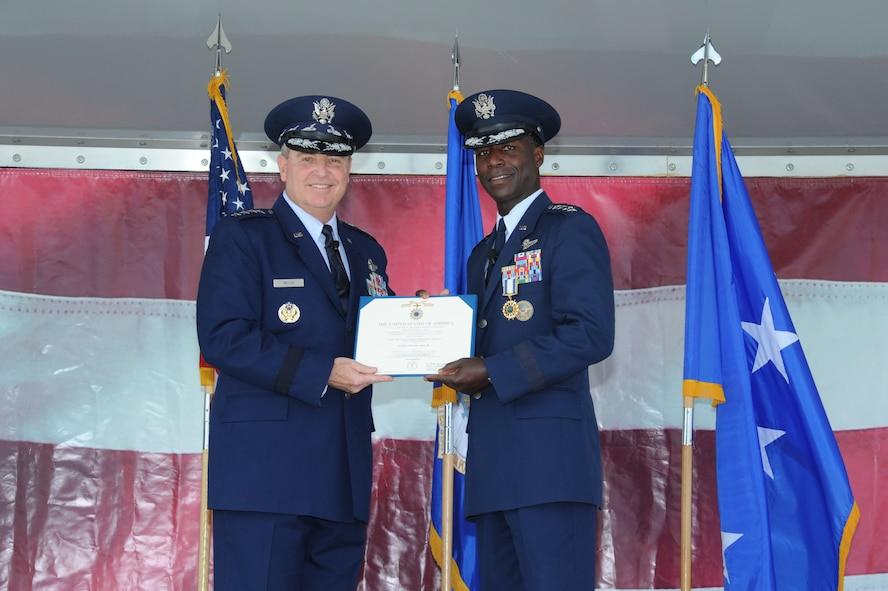 JOINT BASE SAN ANTONIO-RANDOLPH, Texas -- (Right) Gen. Edward A. Rice Jr., former Air Education and Training Command commander, received the Distinguished Service Medal from Air Force Chief of Staff Gen. Mark A. Welsh III, during his retirement ceremony here Oct. 10. (U.S. Air Force photo by Rich McFadden)