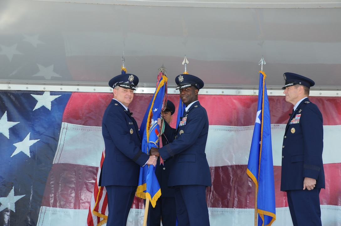 JOINT BASE SAN ANTONIO-RANDOLPH, Texas -- Air Force Chief of Staff Gen. Mark A. Welsh III (left) retrieves the Air Education and Training Command flag from Gen. Edward A. Rice Jr. during a change of command ceremony here Oct. 10, officially relinquishing command. Gen. Robin Rand (right) stands by to assume command of AETC. (U.S. Air Force photo by Rich McFadden)