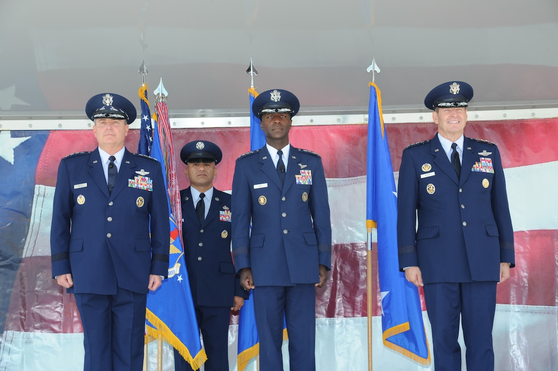 JOINT BASE SAN ANTONIO-RANDOLPH, Texas -- (From left to right) Air Force Chief of Staff Gen. Mark A. Welsh III, Chief Master Sgt. Gerardo Tapia, Air Education and Training Command command chief, Gen. Edward A. Rice Jr., AETC commander, and Gen. Robin Rand, future AETC commander, stand at attention for the advancement of the Color Guard during the AETC change of command ceremony here Oct. 10. (U.S. Air Force photo by Rich McFadden)