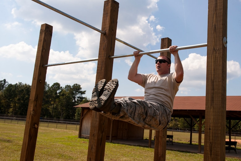U.S. Air Force Tech. Sgt. Jason Dees, a crew chief with the 169th Aircraft Maintenance Squadron, performs a pull up on the newly constructed bars on McEntire Joint National Guard Base, S.C., Oct. 5, 2013. The new pull bars were built by Boy Scouts from troop 95 from Irmo, S.C. (U.S. Air National Guard photo by Staff Sgt. Jorge Intriago/Released)