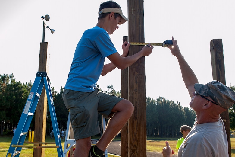 Boy Scouts with Troop 95 from Irmo, S.C., build pull-up bars at McEntire Joint National Guard Base, S.C., as part of their Eagle Scout project with help of the 169th Civil Engineer Squadron, Oct. 5, 2013.  The project is a leadership task and final step before earning Eagle Scout. (U.S. Air National Guard photo by Staff Sgt. Jorge Intriago/Released)
