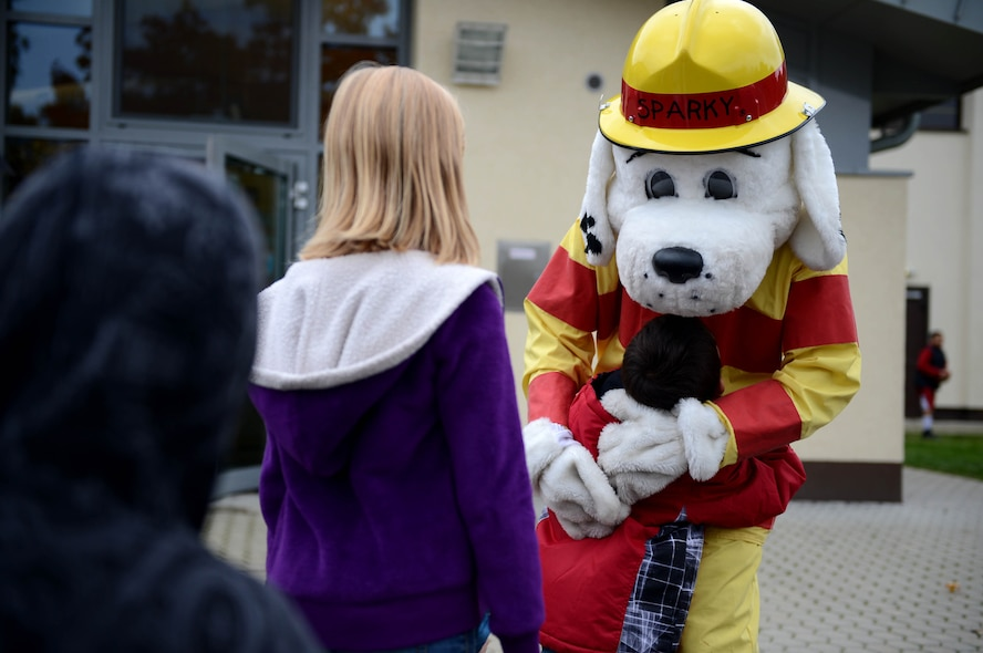 SPANGDAHLEM AIR BASE, Germany – Children from the School Age Program anxiously stand in line to give Sparky the Fire Dog a hug Oct. 9, 2013. Sparky met with children to increase fire safety awareness during fire prevention week. (U.S. Air Force photo by Airman 1st Class Kyle Gese/Released)