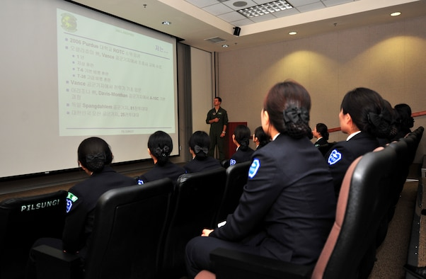 Capt. Michael Dumas, 25th Fighter Squadron A-10 Thunderbolt pilot, briefs Republic of Korea army Reserve Officers' Training Corps cadets from Sungshin University during a tour of Osan Air Base, ROK, Oct. 9, 2013. Dumas, along with 1st Lt. Clancy Morrical, 36th Fighter Squadron F-16 Fighting Falcon pilot, gave nearly 60 cadets a glimpse into what it's like to be an officer and a fighter pilot in the U. S. Air Force. (U.S. Air Force photo/Airman 1st Class Ashley J. Thum)
