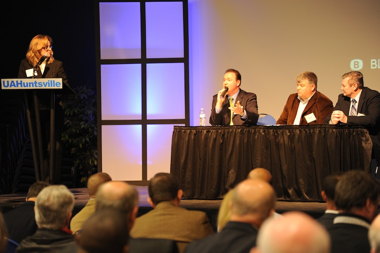 Huntsville Center Small Business Office Chief, Rebecca Vucinaj, left, guides the question and answer period at the 2011 Small Business Forum. The event is an opportunity for small business representatives to talk with contracting officials and program managers from Huntsville Center about the Center's programs and quite possibly small business representatives from the Corps of Engineers Nashville and Mobile districts.