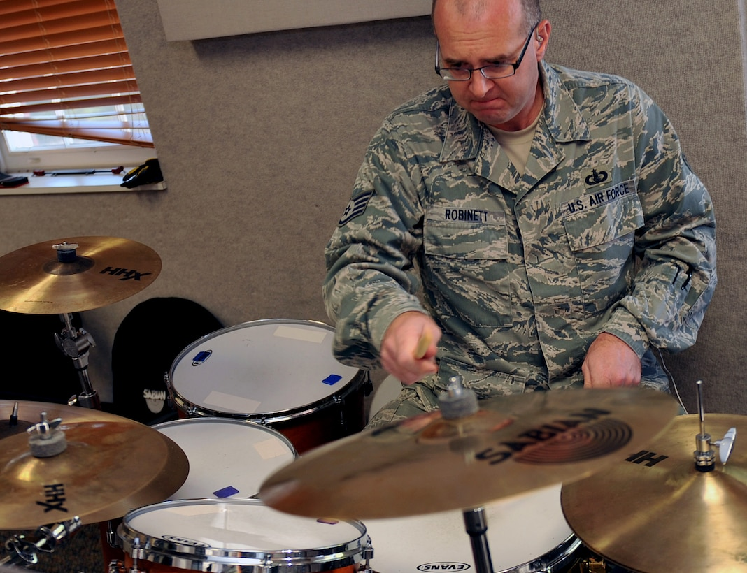 U.S. Air Force Staff Sgt. Jarrett Robinett, a percussionist for the Heartland of America Band, plays drums during a rehearsal Oct. 10, on Offutt Air Force Base, Neb.  The HOAB is categorized as a named activity, which is very similar to a detachment, and falls under the Heritage of America Band chain of command at Joint Base Langley-Eustis, Va.  (U.S. Air Force photo by Jeff W. Gates/Released)
