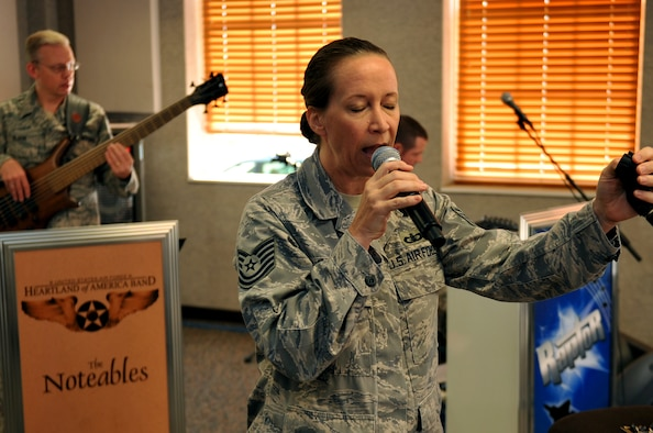 U.S. Air Force Tech. Sgt. Rebecca Packard, a vocalist for the Heartland of America Band, tests her vocal range during a rehearsal Oct. 10, at Offutt Air Force Base, Neb. The HOAB recently transitioned from a 46-piece band to a 16-piece band as part of an overall Air Force restricting. (U.S. Air Force photo by Jeff W. Gates/Released)