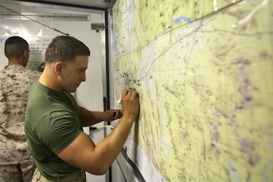 Lance Cpl. Jacob A. Barkstrom, a data network systems technician with Combat Logistics Company 16, Combat Logistics Regiment 15, 1st Marine Logistics Group, maps out the locations of friendly forces in a combat operations center during Weapons and Tactics Instructor Course 1-14 aboard Marine Corps Air Station Yuma, Ariz., Oct. 2, 2013. The COC provided logistical support and services to units from 1st MLG including CLR-15, CLR-1, CLR-17, 7th Engineer Support Battalion, 1st Maintenance Battalion and 1st Medical Battalion during WTI 1-14.