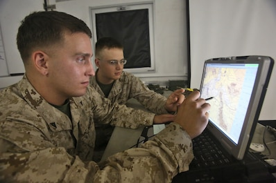 Lance Cpl. Jacob A. Barkstrom, left, and Lance Cpl. Corey R. Dettmann, right, data network systems technicians with Combat Logistics Company 16, Combat Logistics Regiment 15, 1st Marine Logistics Group, locate a convoy using a Blue Force Tracker in a combat operations center during Weapons and Tactics Instructor Course 1-14 aboard Marine Corps Air Station Yuma, Ariz., Oct. 2, 2013. The COC provided logistical support and services to units from 1st MLG, including CLR-15, CLR-1, CLR-17, 7th Engineer Support Battalion, 1st Maintenance Battalion and 1st Medical Battalion during WTI 1-14.