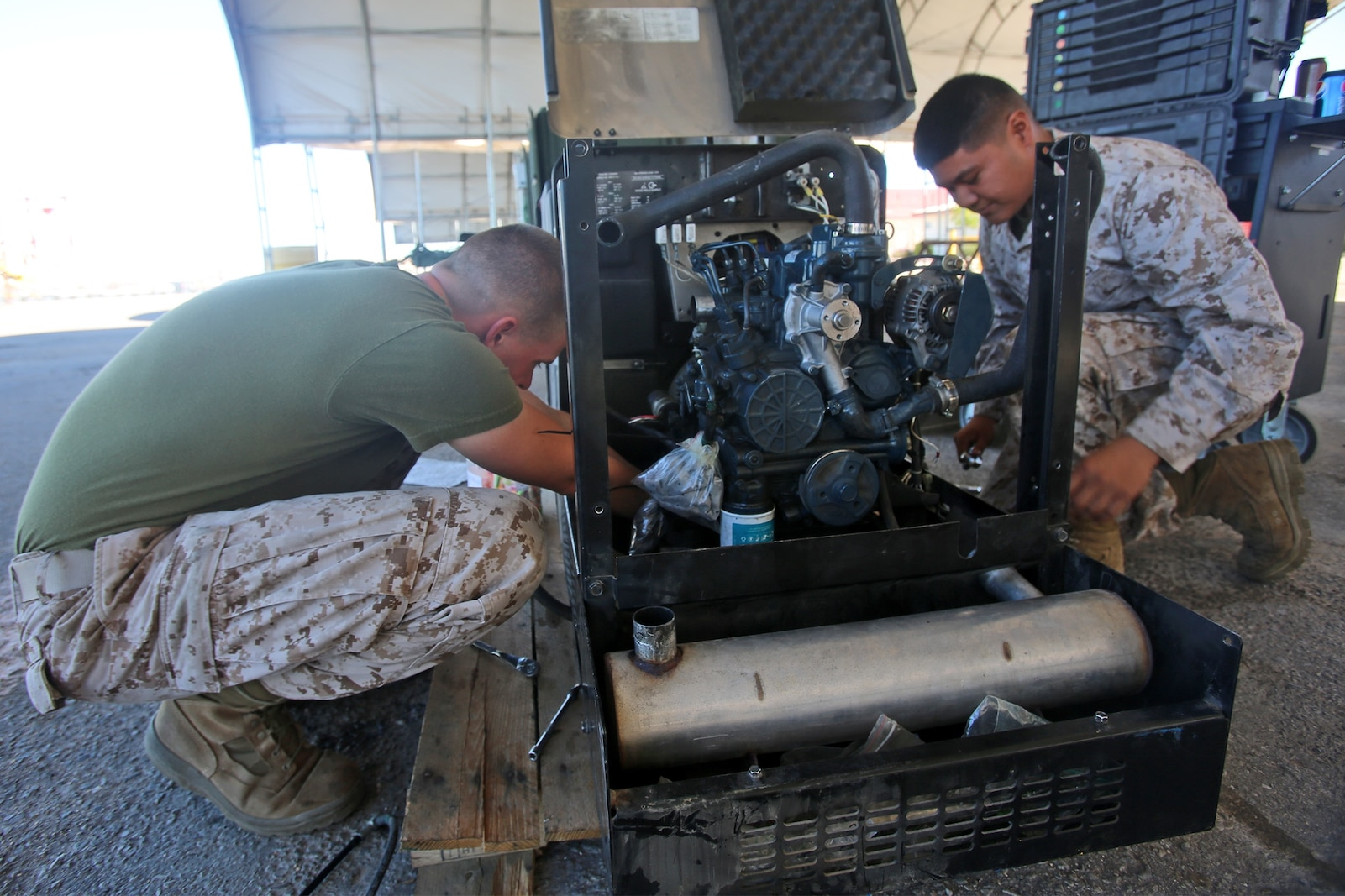 Heavy equipment mechanics with Combat Logistics Company 16, Combat Logistics Regiment 15, 1st Marine Logistics Group, repair a generator at a combat operations center during Weapons and Tactics Instructor Course 1-14 aboard Marine Corps Air Station Yuma, Ariz., Oct. 2, 2013. The COC provided logistical support and services to units from 1st MLG including CLR-15, CLR-1, CLR-17, 7th Engineer Support Battalion, 1st Maintenance Battalion and 1st Medical Battalion during WTI 1-14.