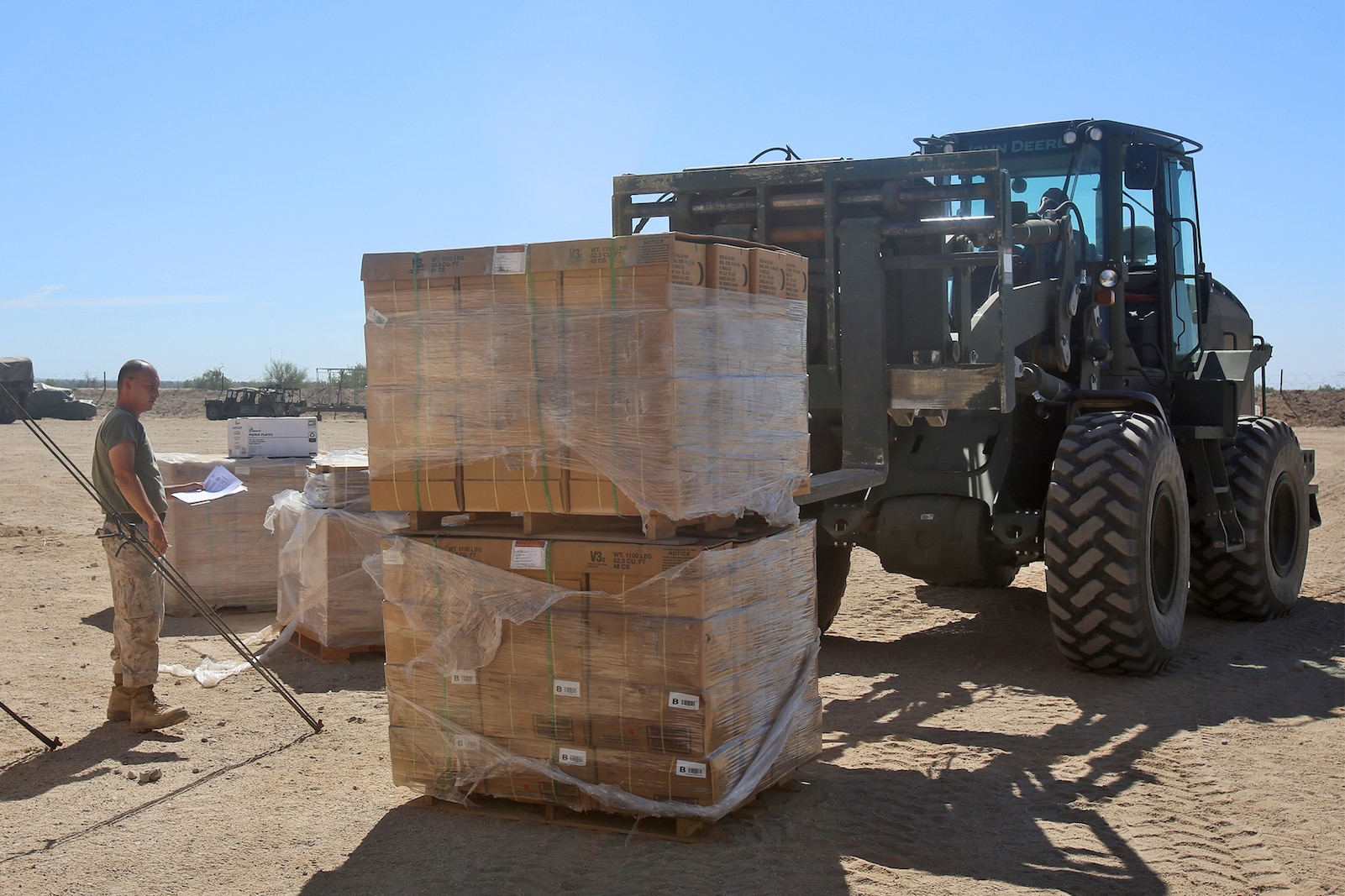 Marines with 1st Supply Battalion, Combat Logistics Regiment 15, 1st Marine Logistics Group, receive supplies from a Combat Logistics Company 16 convoy for distribution to different units during Weapons and Tactics Instructor Course 1-14 in Yuma, Ariz., Oct. 3, 2013. Daily convoys were organized by CLC-16 to provide food, fuel and equipment across Arizona in support of WTI 1-14 and traveled as far as 350 miles for a single resupply operation.