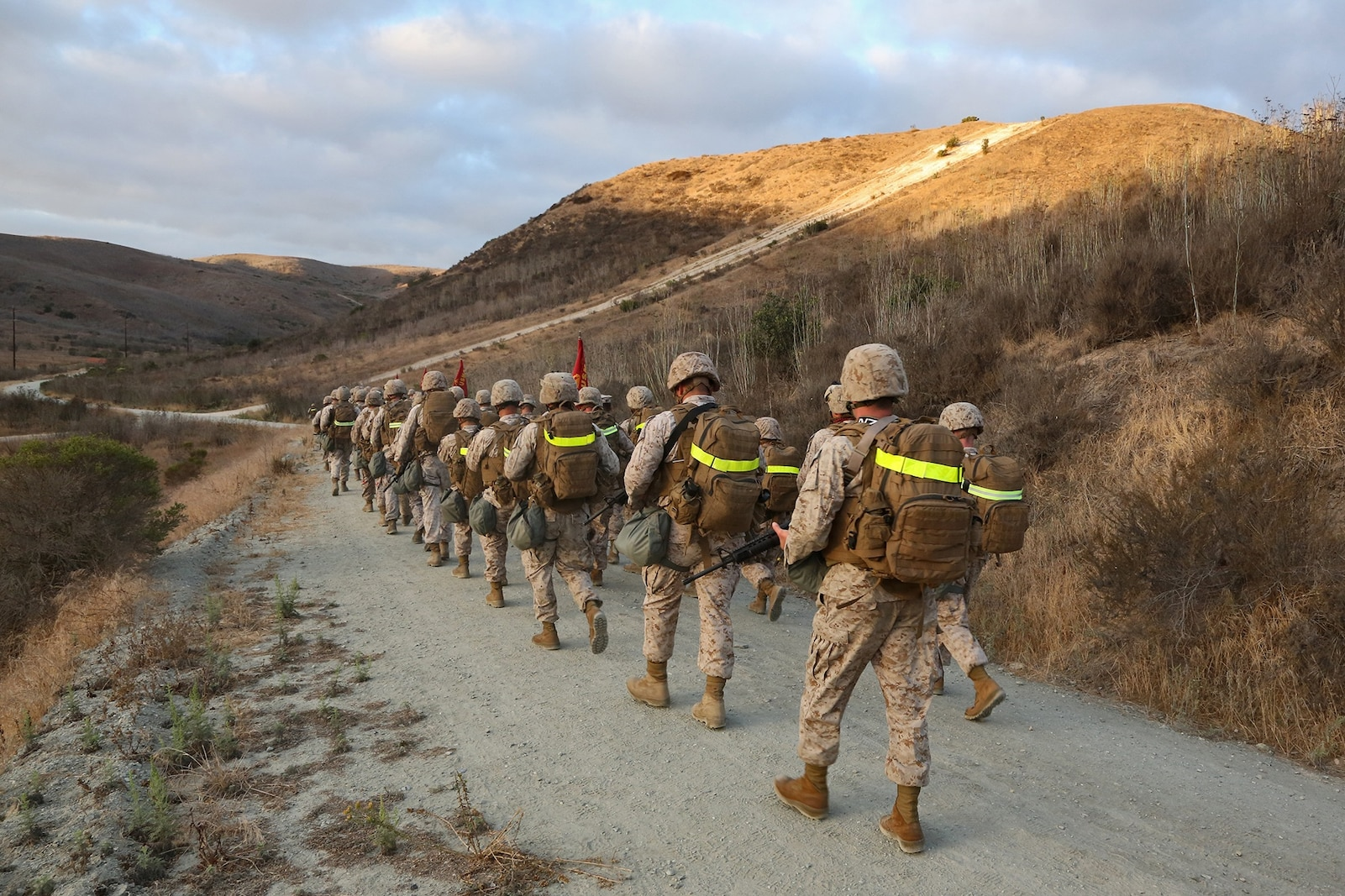 Marines and sailors with Combat Logistics Battalion 15, Combat Logistics Regiment 17, 1st Marine Logistics Group, conduct a battalion hike aboard Camp Pendleton, Calif., Sept. 25, 2013. To physically condition the service members for a combat environment, the battalion hiked more than six miles, carrying a combat load.