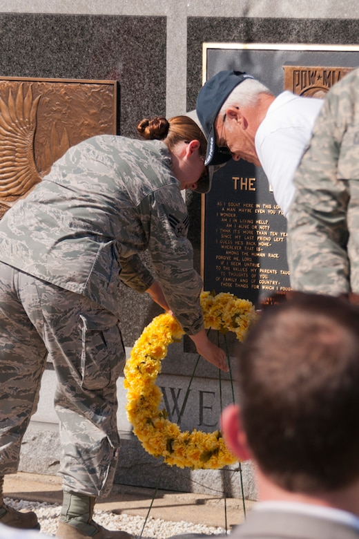 N.H. Air National Guard Senior Airman Jessica Cervantes and Chief Master Sgt. Richard Dolbec (retired) place a wreath at the base of the POW/MIA memorial just outside of Pease Air National Guard Base, N.H., Sept. 20, 2013, as part of a ceremony held during the National POW/MIA Recognition Day. (Air National Guard photo by Tech. Sgt. Aaron Vezeau/Released)