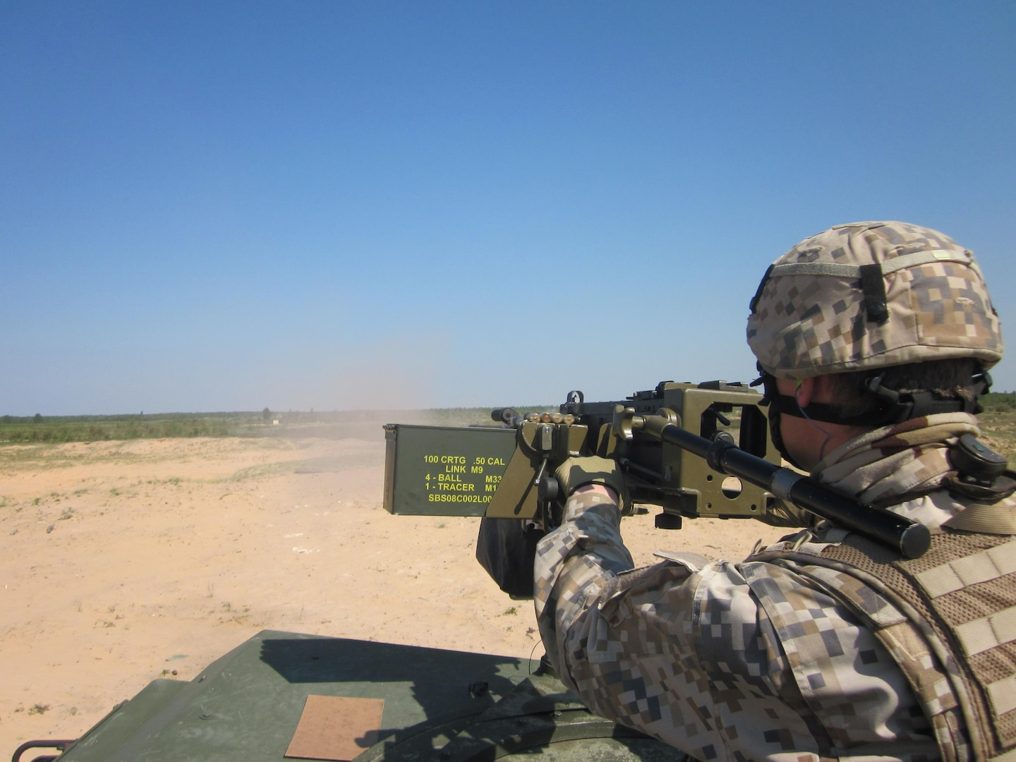 A Latvian soldier engages targets with a High Mobility Multipurpose Wheeled Vehicle mounted .50 machine gun during an exercise as part of joint U.S./Latvian training for Operation Summer Shield in Adaži, Latvia, on May 24, 2011. Latvia is paired with Michigan in the National Guard State Partnership Program.