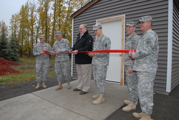 Col. Christopher Lestochi (second from left), district commander of the Alaska District, Terry Parks (middle), president of the Fisher House of Alaska board of directors, and 1st Lt. Dan Frederick (third from right), engineer with the 2nd Engineer Brigade, cut the ribbon Oct. 2 to a new storage shed at the Alaska Fisher House located on Joint Base Elmendorf-Richardson during a dedication ceremony.