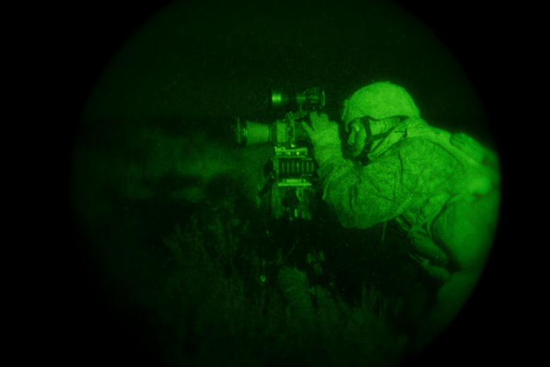 U.S. Marine Cpl. Daniel Soto, 1st Air Naval Gunfire Liaison Company Supporting Arms Liaison Team Delta forward air controller, targets insurgents plating improvised-explosive devices during a night close-air support scenario at Juniper Butte bombing range near Mountain Home Air Force Base, Idaho, Oct. 8, 2013. Realistic training provides the U.S. and partnered warfighters with the combat edge. Mountain Home has hosted the training since 2004 because the base has the right mix of air space, modern ranges and proficient personnel, which creates the perfect location for this type of combined-joint training. (U.S. Air Force photo by Master Sgt. Kevin Wallace/RELEASED)
