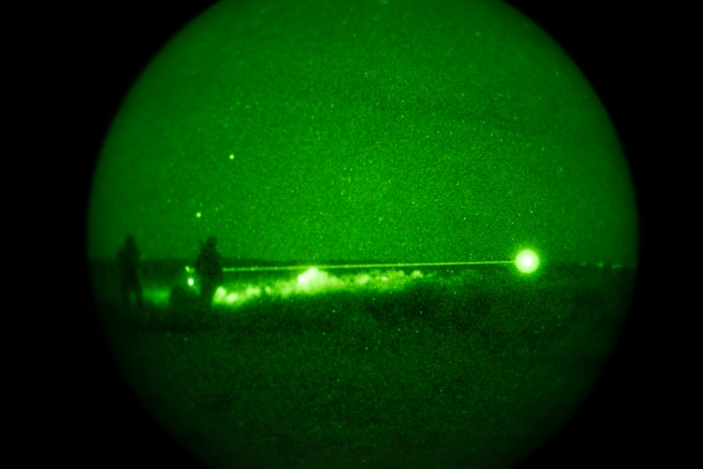 U.S. Marine Capt. Erich Lloyd, Cpl. Andrew Dimauro and Cpl. Daniel Soto, all 1st Air Naval Gunfire Liaison Company Supporting Arms Liaison Team Delta joint terminal attack controllers or forward air controllers, directs close-air support using an infrared pointing and illuminating laser (or B.E. Meyer's 'IZLID') to 'paint' targets for inbound AV-8B Harriers, during exercise Mountain Roundup 2013 at Mountain Home Air Force Base, Idaho, Oct. 8, 2013. The exercise is part of the German Air Force Tornado Fighter Weapons Instructor Course Mission Employment Phase, and is scheduled to end Oct. 16. (U.S. Air Force photo by Master Sgt. Kevin Wallace/RELEASED)
