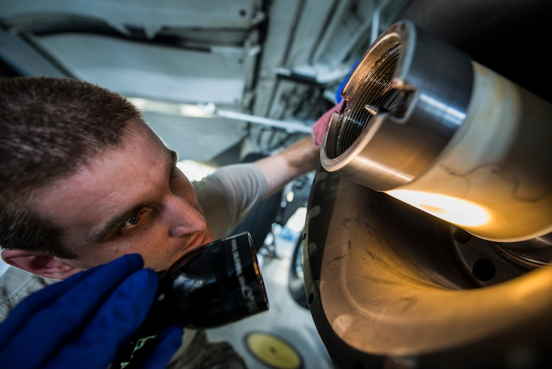 Staff Sgt. Ryan Sova, 437th Maintenance Squadron crew chief, uses a flashlight to check the inside of a gear to make sure nothing is damaged before putting a new tire on a C-17 Globemaster III Oct. 7, 2013, at Joint Base Charleston, S.C. For the crew chiefs to perform a tire change they first need to lift the aircraft off the ground using jacks. (U.S. Air Force photo/ Senior Airman Dennis Sloan)