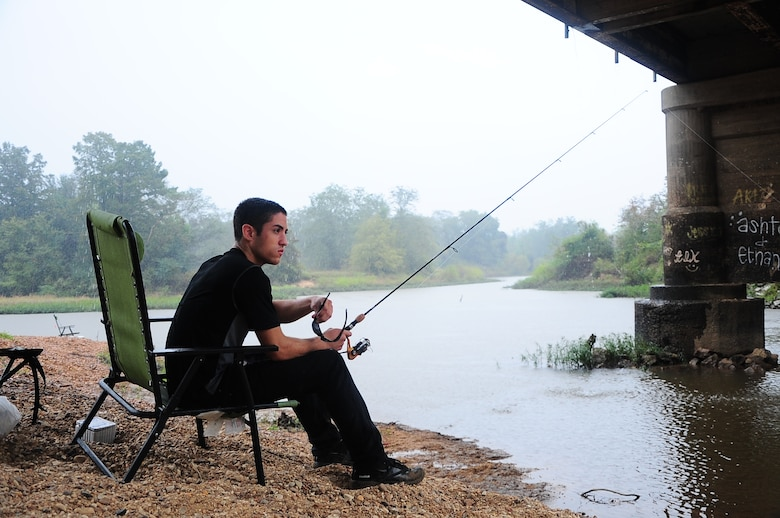 Airman 1st Class James Beadling III, 14th Operations Support Squadron, goes fishing Oct. 5 at the RiverWalk in Downtown Columbus, Miss. There are many places to go fishing on and around Columbus Air Force Base. (U.S. Air Force Photo/Airman Daniel Lile)