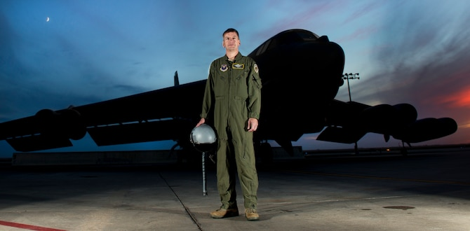 Col. Max B. Mitchell stands in front of the B-52H Stratofortress for the last time as an active duty Airman, Oct. 9. After serving as vice wing commander of the 5th Bomb Wing, Mitchell officially retired from the U.S. Air Force, Oct. 11. Mitchell served 25 years with nearly 4,000 flying hours in the B-52 as a master navigator. (U.S Air Force photo/Tech. Sgt. Aaron Allmon)