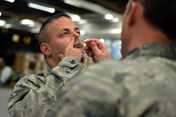 SPANGDAHLEM AIR BASE, Germany—Tech. Sgt. Damian Horton, 52nd Aircraft Maintenance Squadron flightline expediter, from Cooper City, Fla., receives his flu mist injection during a medical exercise Oct. 16, 2013. The 52nd Public Health Emergency Office leveraged the exercise to demonstrate the wing's capability to service the base population in the event of a disease threat or outbreak as efficiently as possible. (U.S. Air Force photo by Senior Airman Alexis Siekert/Released)