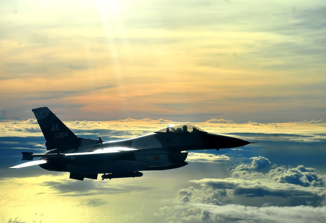 An F-16C Fighting Falcon with the 18th Aggressor Squadron flies an air-to-air combat mission in support of Cope North 13 Feb. 12, 2013, near Anderson Air Force Base, Guam. The Aggressors job is to know, teach and replicate the threat better than any other squadron. Cope North is an annual air combat tactics, humanitarian assistance and disaster relief exercise designed to increase the readiness and interoperability of the U.S. Air Force, Japan Air Self-Defense Force and Royal Australian Air Force. (U.S. Air Force photo/Senior Airman Matthew Bruch)