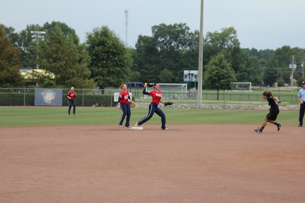MA3 Shasta Rodriguez, Navy Operational Support Center, NC (Navy) (Center) with SPC Miranda Campbell, Camp Casey, Korea (Army) (left) turn a double play at the 2013 ASA National Softball Championship in Ridgeland, MS 26-30 September.  The Armed Forces Women took their 7th consecutive silver medal at the USA National Championship
