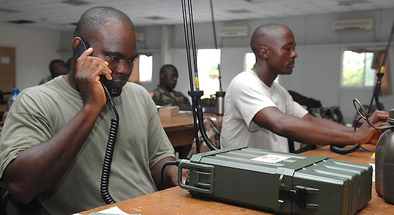 "An Armed Forces of Liberia soldier tests his work after programming frequencies into a CODAN 2110 Manpack Transceiver during a radio familiarization class at Camp Ware, Liberia, Sept. 11, 2013. With support from the U.S. Embassy Office of Security Cooperation, OOL mentors delivered a package of CODAN radios and provided training on the equipment to AFL communications soldiers. OOL provides mentorship to the AFL to produce a capable, respected force able to protect Liberian interests in the West African region. In addition, OOL is developing the leadership capabilities of the officers and noncommissioned officers to maintain a professional and credible military force with a reputation as a ""force for good"" among the Liberian people."