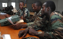 "Armed Forces of Liberia soldiers program frequencies into a CODAN 2110 Manpack Transceiver during a radio familiarization class at Camp Ware, Liberia, Sept. 11, 2013. With support from the U.S. Embassy Office of Security Cooperation, OOL mentors delivered a package of CODAN radios and provided training on the equipment to AFL communications soldiers. OOL provides mentorship to the AFL to produce a capable, respected force able to protect Liberian interests in the West African region. In addition, OOL is developing the leadership capabilities of the officers and noncommissioned officers to maintain a professional and credible military force with a reputation as a ""force for good"" among the Liberian people."