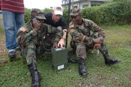 "Jon O'Keeffe, CODAN sales engineer, demonstrates how Armed Forces of Liberia soldiers can use the CODAN 2110 Manpack Transceiver to send text messages as an alternate to verbal communication during a radio familiarization class at Camp Ware, Liberia, Sept. 11, 2013. With support from the U.S. Embassy Office of Security Cooperation, OOL mentors delivered a package of CODAN radios and provided training on the equipment to AFL communications soldiers. OOL provides mentorship to the AFL to produce a capable, respected force able to protect Liberian interests in the West African region. In addition, OOL is developing the leadership capabilities of the officers and noncommissioned officers to maintain a professional and credible military force with a reputation as a ""force for good"" among the Liberian people."