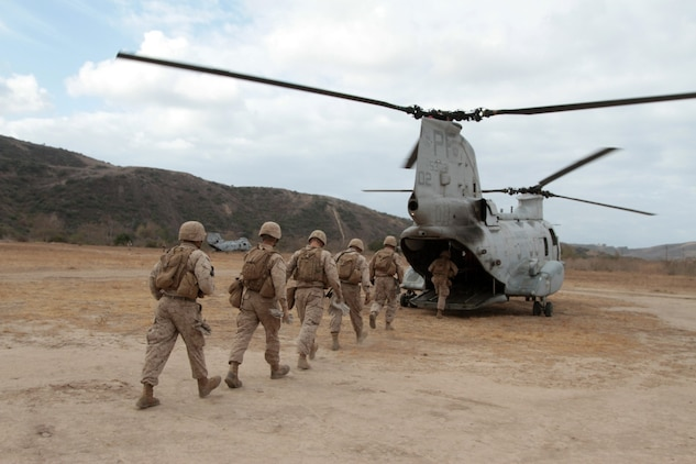 MARINE CORPS BASE CAMP PENDLETON, Calif. -- Marines serving with Kilo Company, 3rd Battalion, 5th Marine Regiment, board a CH-46 Sea Knight helicopter during a fast rope training exercise here, Oct. 9, 2013. Fast roping allows Marines to quickly enter an area without the need for a landing zone. The technique is often employed during raids, enabling forces to rapidly secure an objective. The battalion is scheduled to deploy next spring as the battalion landing team for the 31st Marine Expeditionary Unit in Okinawa, Japan. Kilo Co. is currently assigned as the helicopter element within the battalion landing team.